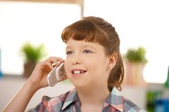 Little girl using cellphone Stock Images