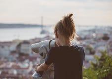 Little girl using telescope. Stock Photos
