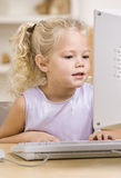 Little Girl Using Computer Royalty Free Stock Photo