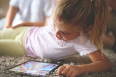 Little girl using digital tablet. royalty free stock photography