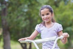 Little girl using her bike Stock Photos