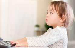 Little girl using her computer Royalty Free Stock Image
