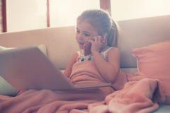 Little girl using her laptop. Stock Photography
