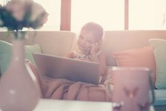 Little girl using her laptop. Royalty Free Stock Images