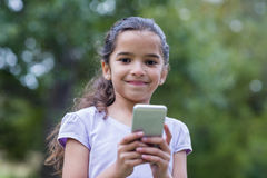 Little girl using her phone Stock Images