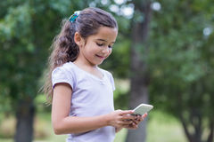 Little girl using her phone Royalty Free Stock Photography