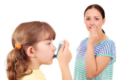 Little girl using inhaler Royalty Free Stock Photos