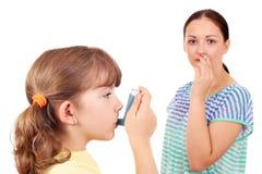 Little girl using inhaler Royalty Free Stock Photos