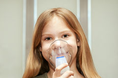 Little girl using an inhaler Stock Image