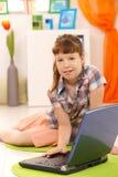 Little girl using laptop Stock Photo