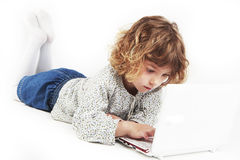 Free Little Girl Using Laptop Stock Photography - 31467172