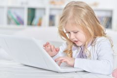 Little girl using laptop Stock Photography