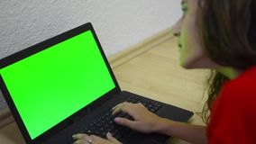 Little girl using laptop stock video footage
