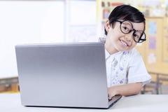 Little Girl Using Laptop Computer Stock Photos