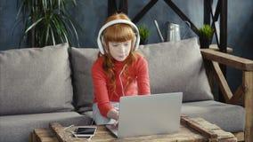 Little girl using laptop stock video