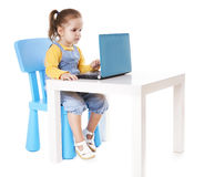 Little Girl Using Laptop - Isolated - Stock Image Royalty Free Stock Photography
