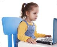 Little Girl Using Laptop - Isolated - Stock Image Stock Photography