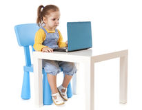 Little Girl Using Laptop - Isolated - Stock Image Royalty Free Stock Images