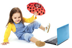 Little Girl Using Laptop Royalty Free Stock Photos