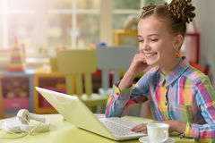 Little girl using laptop Royalty Free Stock Image