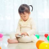 Little girl using mobile phone Royalty Free Stock Images