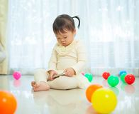 Little girl using mobile phone Stock Photography