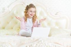 Little girl using modern laptop Royalty Free Stock Photo