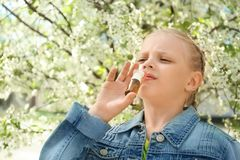 Free Little Girl Using Nasal Drops Near Blooming Tree. Allergy Concept Royalty Free Stock Photography - 150106617