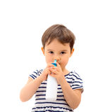 Little girl using nasal spray isolated Royalty Free Stock Photo