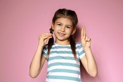 Little girl using sign language on background stock photos