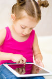 Little girl using tablet computer Stock Photos