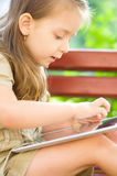 Little girl using tablet Royalty Free Stock Images