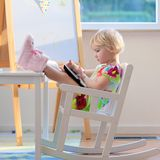 Little girl using tablet pc Stock Photos