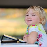 Little girl using tablet pc at home Royalty Free Stock Images