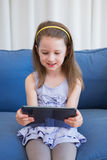 Little girl using tablet pc Stock Photo