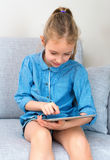 Little girl using tablet pc. Royalty Free Stock Image