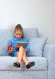 Little girl using tablet pc. Stock Photo