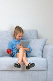 Little girl using tablet pc. Royalty Free Stock Photography