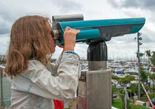 Little girl using telescope. Royalty Free Stock Photos