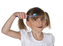 Little girl using toothbrush Stock Photography