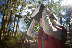 Little girl using virtual reality headset. In the forest Royalty Free Stock Photo
