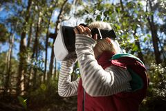 Little girl using virtual reality headset. In the forest Stock Images