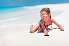 Little girl on vacation. Adorable little girl at beach during summer vacation Royalty Free Stock Photography