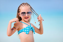 Little girl on vacation. Adorable little girl with Caribbean braids on vacation Stock Photo
