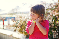 Little girl on vacation enjoys sun. Royalty Free Stock Photo