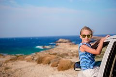 Little girl on vacation travel by car with beautiful view Stock Image