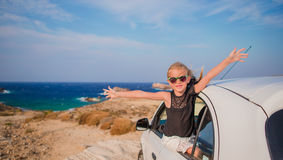 Little girl on vacation travel by car. Summer holiday and car travel concept Stock Photo