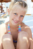 Little girl vacationers in a sunny summer day. Portrait of a little girl vacationers in a sunny summer day Royalty Free Stock Photography