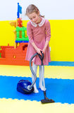 Little girl with vacuum cleaner. Stock Images