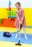 Little girl with vacuum cleaner. Royalty Free Stock Photo